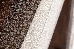 Frost Covered Brown Wood. Frosted snowflakes and ice on natural brown wood. Copyspace area for winter design and construction based themes and concepts royalty free stock photography