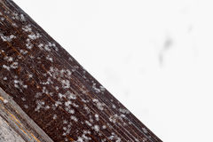 Frost Covered Brown Wood. Frosted snowflakes and ice on natural brown wood. Copyspace area for winter design and construction based themes and concepts royalty free stock photo