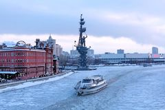 MOSCOW, RUSSIA - JANUARY 11, 2019: Riverboat makes its way along the Moscow River covered with ice. stock image