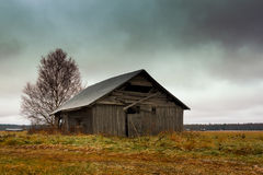 Frost On The Fields And Barns. The first snow came in October in the Northern Finland. It soon melted away but left some frost on the fields and on the roof of Stock Photography