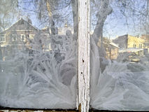 Frost on frozen glass windows. The pattern of frost on frozen glass windows in the Russian winter Stock Photo