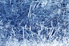 Frost on glass. Blue frost on glass background Royalty Free Stock Photos