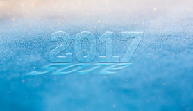 Frost glowing shiny blurred new year 2017 passes 2016 greetings Stock Photography
