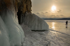 Frost before grotto in the rock. Sunset winter landscape in Lake Baikal. Royalty Free Stock Images