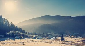 Frost, misty sunrise in mountain village. gorgeous winter, morning foggy landscape Stock Photography
