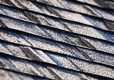 Frost on a newly shingled roof creating an interesting design. Shot with a 500mm lens stock photo