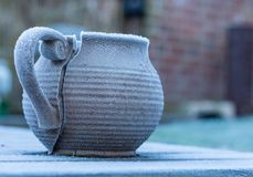 A frost-nipped vase got damaged in a very cold winter night. Royalty Free Stock Photo