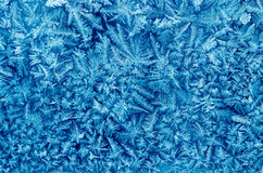Frost pattern crystals on house window macro Royalty Free Stock Photo