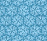 Frost pattern. Stylized frost pattern in a shape of elaborate snowflakes on blue background Royalty Free Stock Images