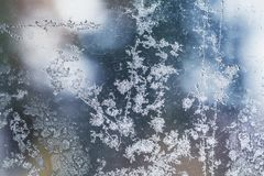 Frost pattern on window glass closeup abstract Royalty Free Stock Photo