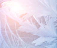Frost pattern. On a windowpane at sunrise, hipster style Stock Images