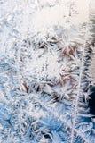 Frost pattern on winter window Stock Photos
