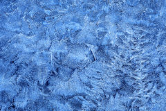 Frost patterns on window glass in winter Royalty Free Stock Photo