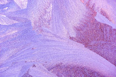 Frost patterns on window glass in winter. Frosted Glass Texture. Blue and purple Stock Photo