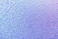 Frost patterns on window glass in winter. Frosted Glass Texture. Blue and purple Royalty Free Stock Photos