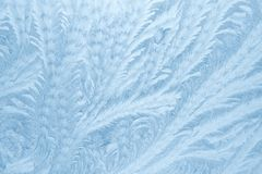 Frost patterns on window glass in winter season. Frosted Glass Texture. Blue background. Frost patterns on window glass in winter season. Frosted Glass Texture stock photos