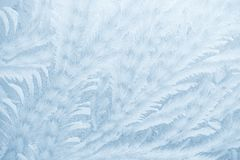 Frost patterns on window glass in winter season. Frosted Glass Texture. Blue background. Frost patterns on window glass in winter season. Frosted Glass Texture royalty free stock photography
