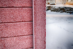 Frost on red wall. A cold winter day stock images