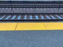 Frost settles on railroad tracks along station platform stock images