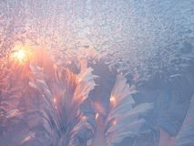 Frost and sun. On winter glass natural texture stock images