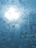 Frost and sun. Frosty natural pattern and sun on winter window Stock Images