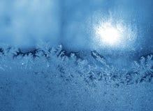 Frost and sun. On winter window Stock Photos