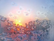 Frost and sun. On winter window stock photography