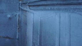 Frost sur la porte Photo stock