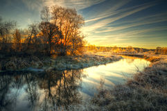 Frost on trees and grass. Dawn at the river .osen. frost on trees and grass Royalty Free Stock Images