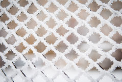 Frost und Schnee auf einem Zaun Lizenzfreies Stockfoto