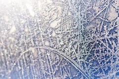 Frost window. Extreme close-up shot of frozen window with beautiful natural ice ornament (partial blurred Royalty Free Stock Photo