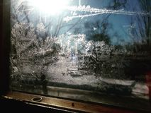 Frost on Window Pane with Sunlight Shining stock photography