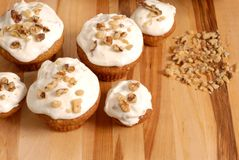 Frosted banana walnut muffins. With chopped nuts Stock Photos