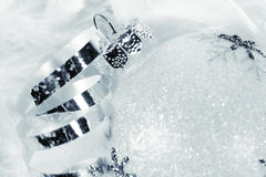 Frosted bauble for Christmas. Frosted Christmas bauble with silver curly ribbon in luxurious snow-white feathers Royalty Free Stock Images