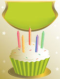 Frosted birthday cupcake with placard. On tan star background Stock Photos