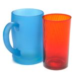 Frosted blue glass mug and Red glass beaker Stock Photo