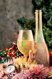 Frosted bottle and glass of champagne. On New Year's table Royalty Free Stock Images