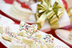 Frosted cake pieces with sprinkles Royalty Free Stock Image