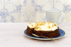 Frosted carrot and walnut cake. Stock Photography