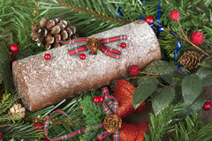 Frosted christmas chocolate log with glittered bells and pine co stock photography