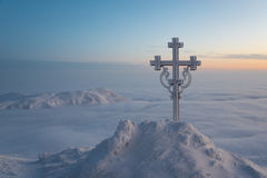 Frosted cross against charming nature Stock Photo