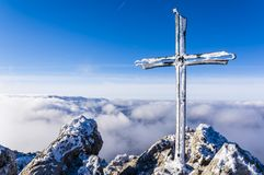 Frosted cross on a mountain peak Velky Rozsutec in Mala Fatra in Slovakia royalty free stock photos