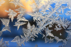 Frosted designs on glass. Severe frost pattern on the glass Stock Photo