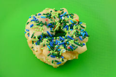 Frosted donut with sprinkles Stock Photography