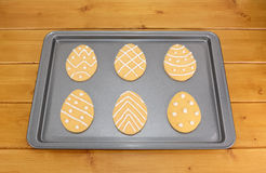 Frosted Easter egg cookies on a baking tray Stock Photo