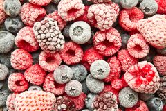 Frozen berries background. Frozen blueberry, blackberry,raspberry. Frosted or frozen mix berries Royalty Free Stock Photography