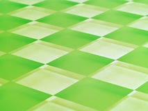 Frosted Glass Checkerboard in Lime Green. A glass checkerboard with clear and frosted squares with mirrored effect, tinted lime green Royalty Free Stock Image