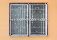 Frosted Glass Louver Windows with Curved Steel on Orange Concrete Wall stock photo