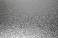 Frosted glass texture as background. Grey color Royalty Free Stock Image