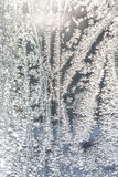 Frosted glass texture. Frost pattern on the window. Abstract blue frost background Stock Photos